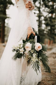 Modest bouquet with muted pastel florals and moody greenery | Image by Lukas Korynta #elopement #elope #elopementinspiration #winterwedding #winterelopement #wedding #weddinginpspiration #vintagewedding #bouquet #weddingbouquet #bridalbouquet #weddingflowers