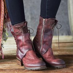 """KATARINA BOOTS--Compelling and completely unique, these handcrafted, leather and oiled suede boots are unforgettable. Adjustable inner laces and snaps with side zippers. Imported. Euro whole sizes 36 to 41. 36 (US 6.5), 37 (US 7.5), 38 (US 8.5), 39 (US 9.5), 40 (US 10), 41 (US 10.5), 42 (US 11). 2"""" heel."""