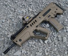 IMI Tavor TAR 21 :  Short and compact, the TAR 21 was developed as a CQB rifle capable of engaging standard distances.  Its piston design  provides incredible reliabilty while its ergos allow for fast efficient operation for both right and left shooters.  The 5.56 cartridge and NATO STANAG mags functions well for combative engagemets and the hunting of small to medium game. Its small size and unique balance makes it an Ideal scout weapon.