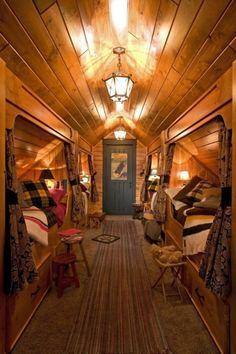 Hallway bunk room stuck under the eaves. Lands End Development - Designers & Builders. great use of attic space.