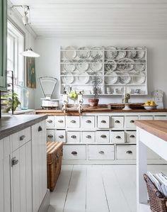 A HomeLife Magazine Favorite! shabby white kitchen (via justbesplendid)
