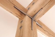 This is post & beam, whereas you can use mechanical fasteners. Timberframes use only mortise & tenon with wood pegs. This is still an elegant joinery.