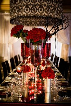 black damask table settings | Table setting for a red, black, and white wedding with roses and ...