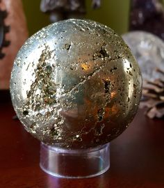 A personal favorite from my Etsy shop https://www.etsy.com/listing/286612399/stunning-pyrite-sphere-shown-with-clear