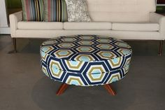 ottoman: love the idea of adding a print or pop of color to a room with the ottoman