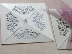 French Flair laser cut wedding invitations showing the pale blue with fleure de lis