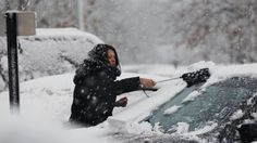 A woman clears snow from her parked car Wednesday, Nov. 7, 2012, in Dover Township, N.J., as the region pounded by Superstorm Sandy last week is hit by a Nor'Easter. Gov. Chris Christie warned Wednesday that New Jersey may suffer a setback in its Superstorm Sandy recovery efforts as a result of the new storm.