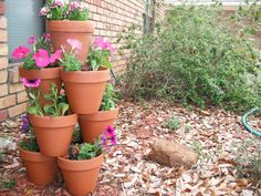 Stacked flower pots a few of my favorite things stacked flow Clay Pot Projects, Clay Pot Crafts, Stacked Flower Pots, Pea Trellis, Garden Ideas Diy Cheap, Painted Clay Pots, Flower Video, Plant Supports, Garden Planters