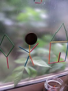 "I'm thinking wikki stix on the window, after looking at this inspiring picture, but one pinner said, ""Another great use for Contact Paper: Sticky Window Art - Fine Motor and Sensory activity #craftsforkids #finemotor"