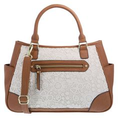 """Perfect for an outing with friends, the Rebekka features a tumbled outer with crochet on the front panel, plus a front zippered pocket and two open side pockets, zippered close, lined interior with one zippered pocket and two side pockets, dual padded handles, and an optional crossbody strap that extends to a 25"""" drop. Measures approximately 9""""HX13""""WX4 1/2""""D. Manmade materials."""