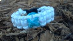This is a White Bracelet with the Teal/Turquoise Breast Cancer Symbol weaved into it. It is made with a curved buckle that contours your Paracord Bracelets, Paracord Ideas, I Miss My Mom, Ovarian Cancer Awareness, Thing 1, Cancer Support, Teal, Turquoise