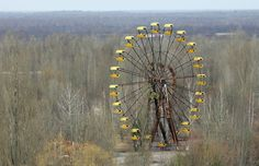 A Ferris Wheel is seen in the ghost town of Pripyat, which was evacuated after a nuclear disaster in Chernobyl, April 13, 2006. (Reuters/Gleb Garanich) #