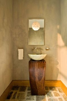 awesome idea for a bath when you don't need storage. Beautiful simple yet elegant rustic bathroom with a wooden stump base, stone vessel sink, flagstone floor, and stucco walls for a distinctive European Villa look. By Witt Construction. Small Bathroom Vanities, Vessel Sink Bathroom, Pedestal Sink, Chic Bathrooms, Bathroom Ideas, Wood Bathroom, Small Bathrooms, Simple Bathroom, Minimal Bathroom
