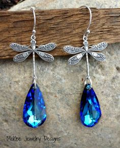 Sterling silver earrings, dragonfly charms and Bermuda Blue Swarovski crystals. McKee Jewelry Designs