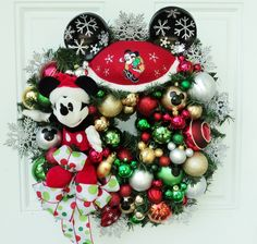 Mickey Mouse Christmas Wreath Red Snowflakes. $160.00, via Etsy.