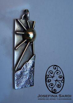 colgante de plata y bronce