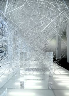 Snowflake by Tokujin Yoshioka - installation using hundreds of transparent plastic sticks at the Kartell showroom in Milan