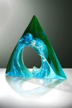 Petr Stacho-WAVE-uranium glass. This Prague artist creates dynamic, natural looking forms in cast glass, then juxtaposes smooth cut surfaces against the flowing shapes and textures. Beautiful. Lots more on the website.