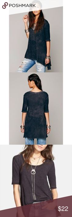 """Free People Melrose Swing Tunic Tee 🌾 Trapeze hi-low swingy T that has been a favorite! And this vintage variation shades of black (per stock pics) is becoming a harder color to find! This one is just too large and long on me. Best for the taller gal, and probably best fit a M because it measures 29"""" front, 33 1/2"""" back, and I love the longer but narrow 12"""" sleeve length. Raw hem & cuffs. 💯 % soft washed cotton. In VGUC except for 2 """"very small"""" shark bites 🦈, in the back, close to hem…"""