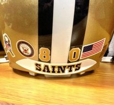 NFL Players will be wearing stickers on the back of their helmets this month for the Salute To Service campaign. Here is Jimmy Graham's helmet with a Navy Seals sticker #Saints #NOLA #WhoDat