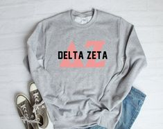 About Delta Zeta Sweatshirt This sweatshirt is Made To Order, we print the sweatshirt one by one so we can control the quality. Fraternity Letters, Sorority Letters, Delta Zeta Shirts, Sorority Shirts, Collared Sweatshirt, Crew Neck Sweatshirt, Custom Clothes, Shirt Designs, Sweatshirts