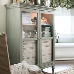 What a gorgeous cabinet! Love the glass doors and the mini drawers. - Aldridge Cabinet