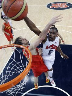 United States' Kevin Durant (5) slam dunks to score over Spain's Pau Gasol, left, during the men's gold medal basketball game at the 2012 Summer Olympics, Sunday, Aug. 12, 2012, in London. (AP Photo/Eric Gay, pool)