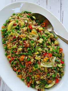Farro Salad full of artichokes, asparagus, peas, peppers, zucchini and other vegetables