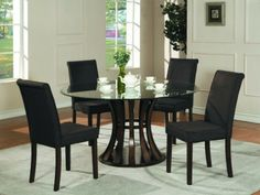 Terrific Glass Top Dining Room Tables: Mesmerizing Contemporary Glass Top Dining Table With Round Glass Table Top White Kettle White Glass Cup Black Side Chairs Gray Fur Rug Glass Windows Laminate Flooring ~ kaliopa.com Dining Room Design Inspiration