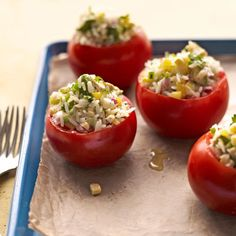 Corn-Stuffed Tomatoes - These succulent summer tomatoes are stuff with fresh vegetables and jasmine rice. To round out the meal, serve with something full of protein, like lean grilled fish or chicken, or a colorful bean salad. #myplate #vegetables #grain
