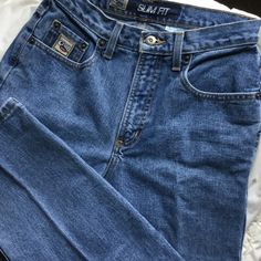 Cruel Girl jeans Cruel Girl jeans in softly worn condition.  Very comfortable, in 100 percent cotton.  Size 9 short.  Measures 24 inches across front waistband, leg inseam is 29 inches.  Sits at waist. Cruel Girl Jeans Straight Leg