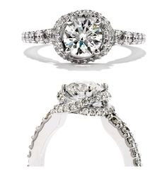 """Hearts on Fire """"Felicity Ribbon"""" complete engagement ring with round brilliant centre and surrounding diamonds."""