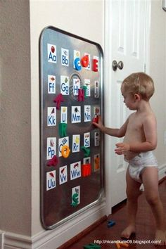 Oil Drip Pan from Walmart. As a giant magnet board ($12) Genius! Toddler Room @ DIY Home Ideas (We have an awesome DIY magnet/chalk board area; but this is super cool and we may need to add it.)