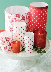 Turn everyday drinking glasses and plain glass vases into festive candles by covering them with patterned paper (attach with double-sided tape). Or spray glasses with spray adhesive and roll them in red glitter.