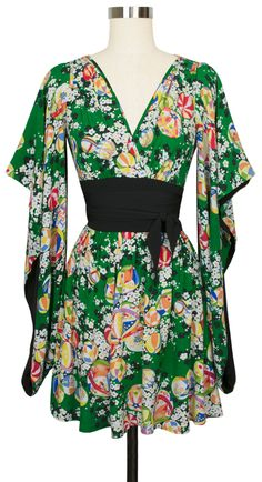 The newest Trashy Diva dress is the Amaya Dress in Green Kimono! With Kimono sleeves and an adjustable wrap belt you are sure to stand out in a crowd!
