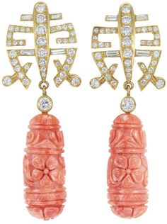 Pair of Gold, Diamond and Carved Coral Pendant-Earrings   18 kt., topped by two diamond-set gold panels of openwork geometric design, suspending 2 coral pendants carved with a floral motif, approximately 28.0 x 11.0 mm., joined by 2 round diamonds, set throughout with 76 round and 8 baguette diamonds approximately 1.90 cts. Via Doyle New York.