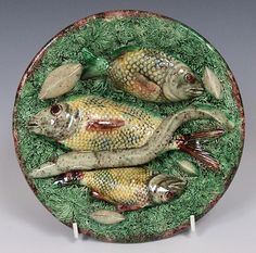 A charming 3 fish, eel and mollusc Portuguese Palissy plate with grass effect ground. Portugal c1880  Dimensions in Inches: Dia: 8ins