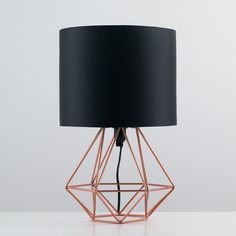 Metal open basket cage table lamp base with a black fabric shade in a copper finish. Ideal For living Rooms, bedrooms and hallways.