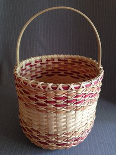 Dimensions: Height to top of basket section: 10 1/2 inches Diameter 11 inches