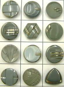 Vintage grey glass buttons. In woods with nice woodgrains or shiny metals though ~ something from the earth!