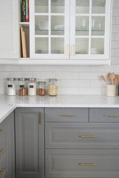 white upper cabinets / gray lower cabinets and white subway tiles w/light gray grout