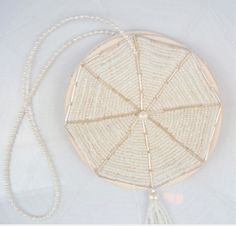 Britten wedding accessories - pearl garters, button holes and even feathered fans