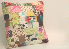 Scrappy Patchwork Quilted Pillow...I must make one of these from the bits and pieces of my 2.5 strips.
