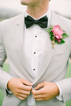 groom in grey white and blac