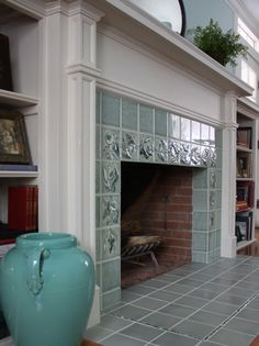 ABOVE: Fireplace after installation of art tile: Arts & Crafts meets Colonial Revival.Photo by TJ Pignataro A bland and damaged surround is remade with a period Fireplace Hearth Tiles, 1930s Fireplace, Fireplace Bookcase, Victorian Fireplace, Home Fireplace, Fireplace Remodel, Fireplace Surrounds, Fireplace Design, Vintage Fireplace