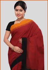 This maroon and black and mustard handloom pochampally ikat mercerized cotton saree is elegantly designed with self weaving, yarn tie