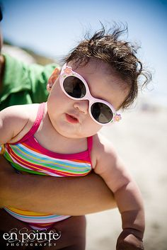 a fat baby in sunglasses... whats not to love ?