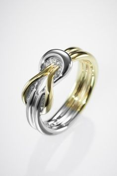 Love Knot Ring <3  PERFECT wedding band.   hmmmm.  i am renewing my vows in vegas this summer...a new ring would be nice. hahah
