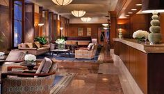 Omni Chicago Hotel: With its dark wood and gold accents, the lobby sets a soothing tone.