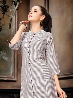 Best 11 Ivory-Purple Striped Handloom Cotton Kurta by Jaypore – SkillOfKing. Simple Kurti Designs, Kurta Designs Women, Salwar Designs, Blouse Designs, Long Kurta Designs, Kurti Sleeves Design, Kurta Neck Design, Shirt Style Kurti, Kurti With Jeans